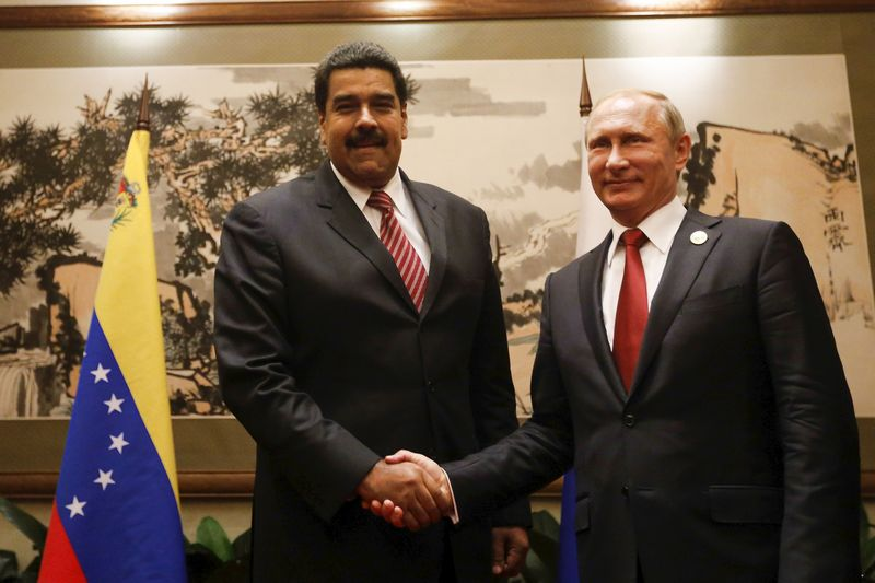 Venezuela's President Nicolas Maduro (L) and Russia's President Vladimir Putin shake hands during their meeting in Beijing, China, in this handout picture provided by Miraflores Palace on September 3, 2015. Russia and Venezuela did not reach agreement on measures to support global oil prices, Russian Energy Minister Alexander Novak told reporters on Friday. Russia and Venezuela need to combine efforts to lift oil prices, Putin told Maduro on Thursday, but refused to spell out any specific action, including output cuts. REUTERS/Miraflores Palace/Handout via Reuters ATTENTION EDITORS - THIS IMAGE WAS PROVIDED BY A THIRD PARTY. REUTERS IS UNABLE TO INDEPENDENTLY VERIFY THE AUTHENTICITY, CONTENT, LOCATION OR DATE OF THIS IMAGE. IT IS DISTRIBUTED EXACTLY AS RECEIVED BY REUTERS, AS A SERVICE TO CLIENTS. FOR EDITORIAL USE ONLY. NOT FOR SALE FOR MARKETING OR ADVERTISING CAMPAIGNS.