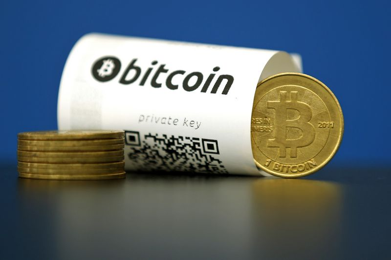 "A Bitcoin (virtual currency) paper wallet with QR codes and a coin are seen in an illustration picture taken at La Maison du Bitcoin in Paris, France, May 27, 2015. British authorities have come out in support of digital currencies in the name of promoting financial innovation, while proposing that regulations should be drawn up to prevent their use in crime. But it is technophiles who are leading the drive to make London a real-world hub for trade in web-based ""cryptocurrencies"", of which bitcoin is the original and still most popular.   Picture taken May 27, 2015.  REUTERS/Benoit Tessier"