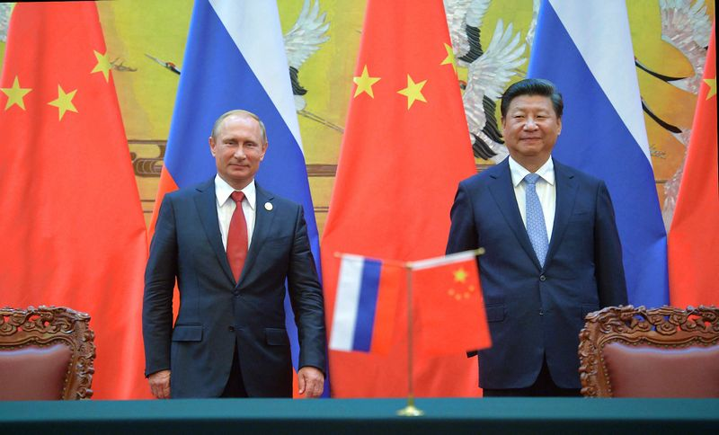 Russian President Vladimir Putin (left) and Chinese President Xi Jinping attend the ceremony of signing documents following Russian-Chinese talks at the Great Hall of the People in Beijing. Alexei Druzhinin/RIA Novosti/Scanpix