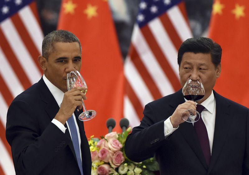 """JAV ir Kinijos vadovų nuomonės esminiais užsienio politikos klausimais dažnai išsiskiria. GREGO BAKERIO (""""REUTERS"""" / """"SCANPIX"""") NUOTR."""