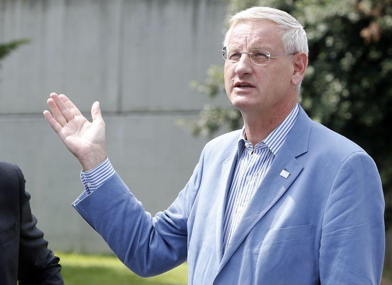 """""""Neįmanoma susitvarkyti su šių laikų problemomis dirbant atskirai"""", – sako Carlas Bildtas, buvęs Švedijos diplomatijos vadovas. ALESSANDRO GAROFALO (""""REUTERS"""" / """"SCANPIX"""") NUOTR."""