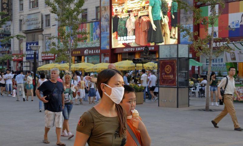 """Kinijos ūkio perversmas - nuo investicijų ir pigaus eksporto į vartojimą - nevyksta taip sklandžiai, kaip tikėtasi. Nicko Hanneso (""""Reporters"""" / """"Scanpix"""") nuotr."""
