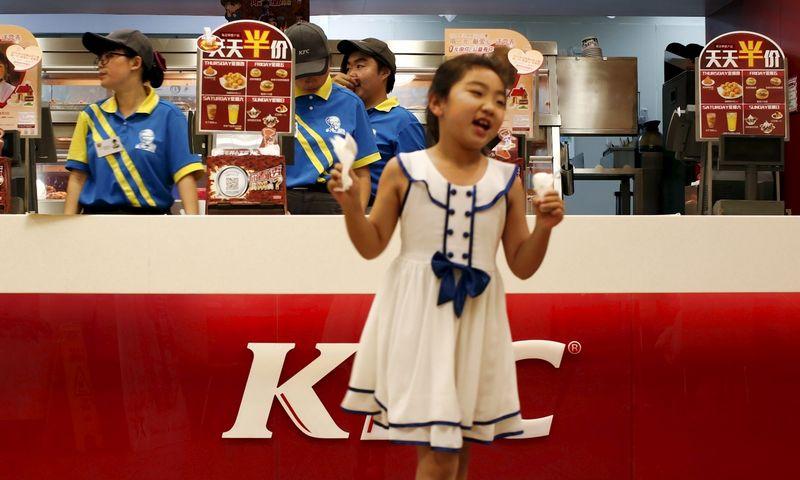 """KFC – populiariausias tarptautinis prekės ženklas Kinijoje.  Kim Kyung-Hoon (""""Reuters"""" / """"Scanpix"""") nuotr."""