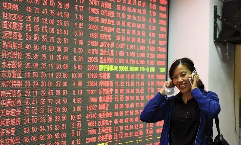 """TVF kol kas nekeitė Kinijos augimo prognozių šiems ir kitiems metams, tačiau pripažįsta, kad iš Pekino kylantys virpesiai pasauliui turi didesnę įtaką nei tikėtasi. """"Reuters"""" / """"Scanpix"""" nuotr."""