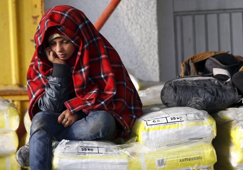 A migrant boy waits to enter a makeshift camp at the Austrian Slovenian border near the village of Sentilj, Slovenia, October 26, 2015.  REUTERS/Leonhard Foeger