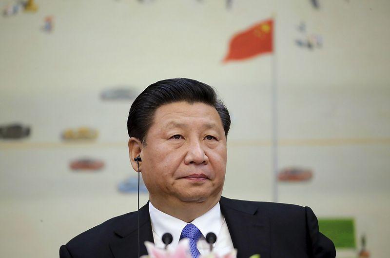 """Kinijos prezidento Xi Jinpingo teigimu, šalies ekonomika artimiausius penkerius metus augs nuosaikiau, bet ne lėčiau nei vidutiniškai 6,5% tempu.  Jasono Lee (""""Reuters"""" / """"Scanpix"""") nuotr."""