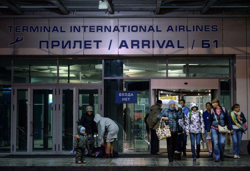 """Turistai iš Egipto grįžta į Novosibirską. Aleksandro Kriaževo (""""RIA Novosti"""" / """"Scanpix"""") nuotr."""