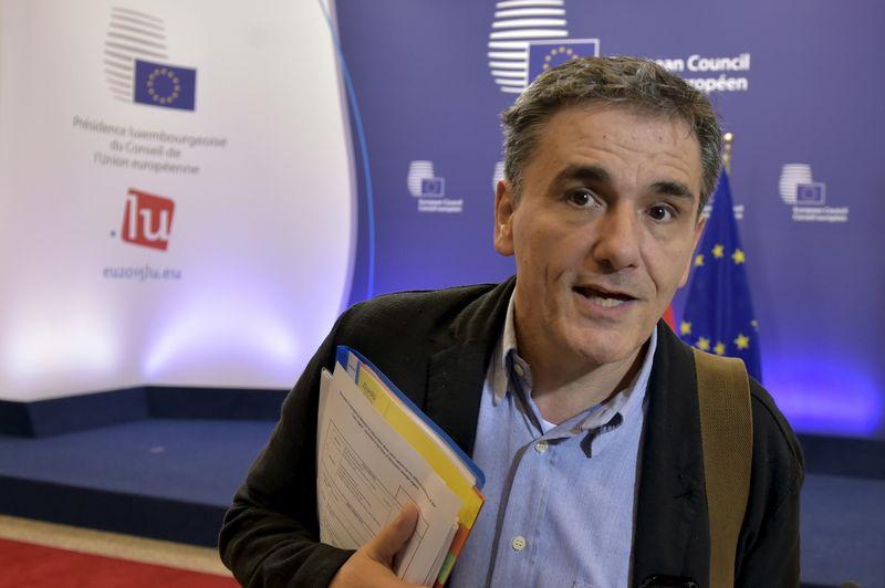 """Po iki paryčių trukusių derybų su tarptautiniais kreditoriais Euclid'as Tsakalotos, Graikijos finansų ministras, konstatvo, kad susitarta dėl visų esminių klausimų. """"Reuters"""" / """"Scanpix"""" nuotr."""