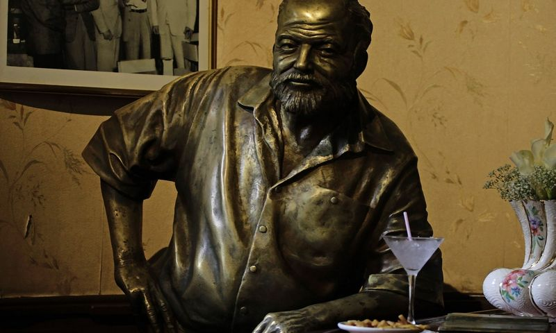 A bronze staue of late Nobel-prize winning author Ernest Hemingway is seen at the 'Floridita' bar in Havana July 2, 2011. REUTERS/Desmond Boylan