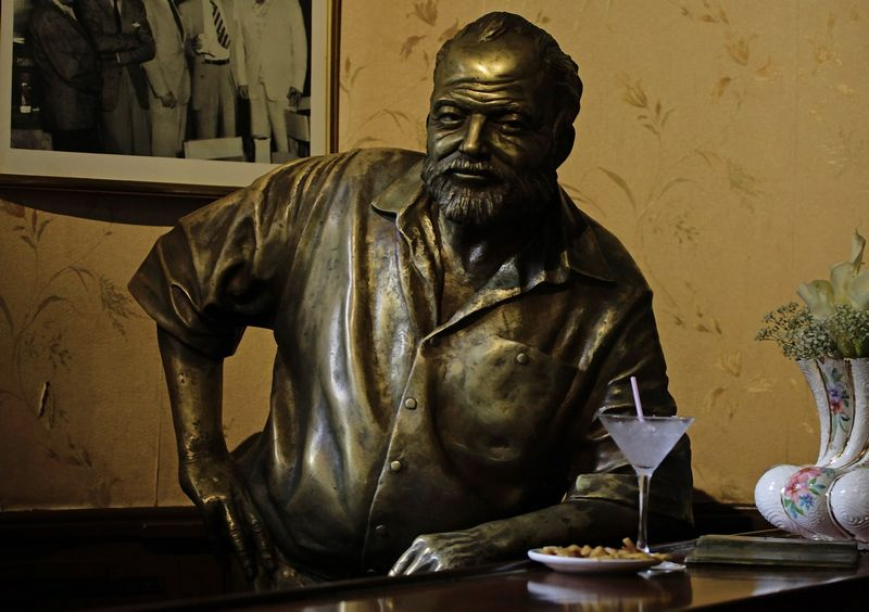 A bronze staue of late Nobel-prize winning author Ernest Hemingway is seen at the 'Floridita' bar in Havana July 2, 2011. REUTERS/Desmond Boylan