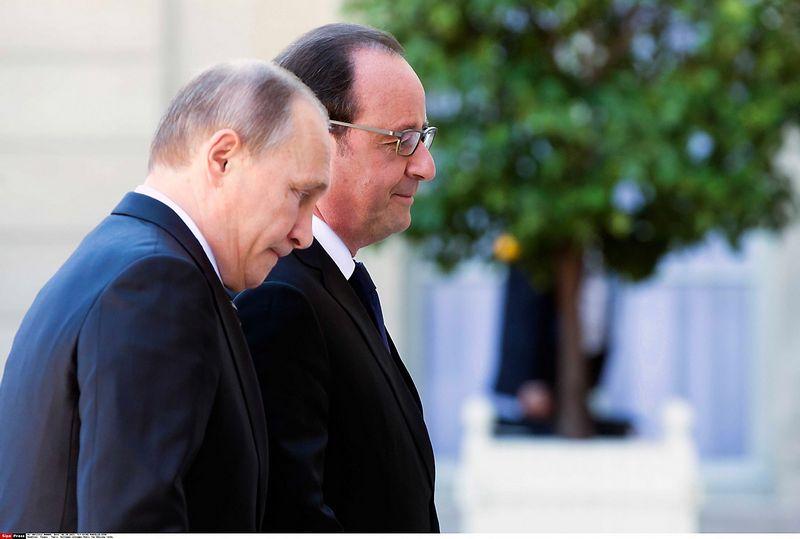 """Vladimiras Putinas siekia pademonstruoti, kad Rusija dabar – svarbiausia Prancūzijos partnerė. Theo Duval (""""Xinhua"""" / """"Scanpix"""") nuotr."""