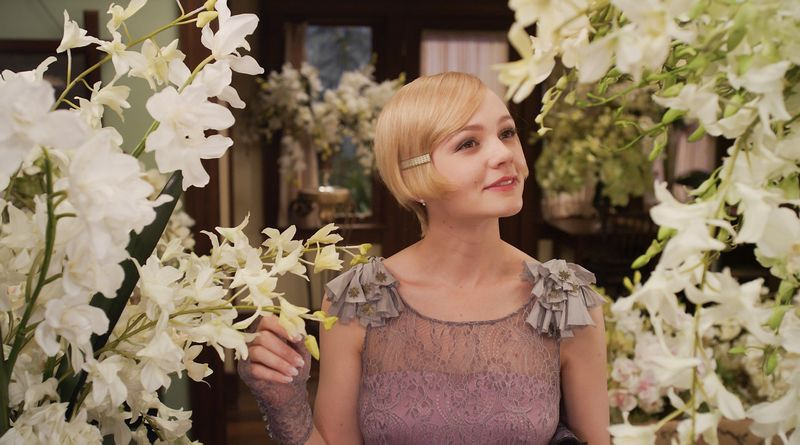 """Kino filme """"Didysis Getsbis"""" (2013 m.) Carey Mulligan vilki nepaprasto grožio sukneles. Nėrinius filmo kostiumams sukūrė visame pasaulyje gerai žinoma bendrovė """"Solstiss"""". Warner Bros/Courtesy Everett Collection/ Vida Press nuotr."""