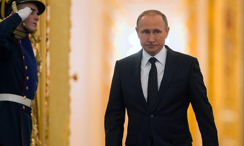 """Rusijos prezidentas Vladimiras Putinas ketvirtadienį kreipėsi į Federalinį susirinkimą. Sergejaus Gunejevo (""""Sputnik"""" / """"Reuters"""") nuotr."""