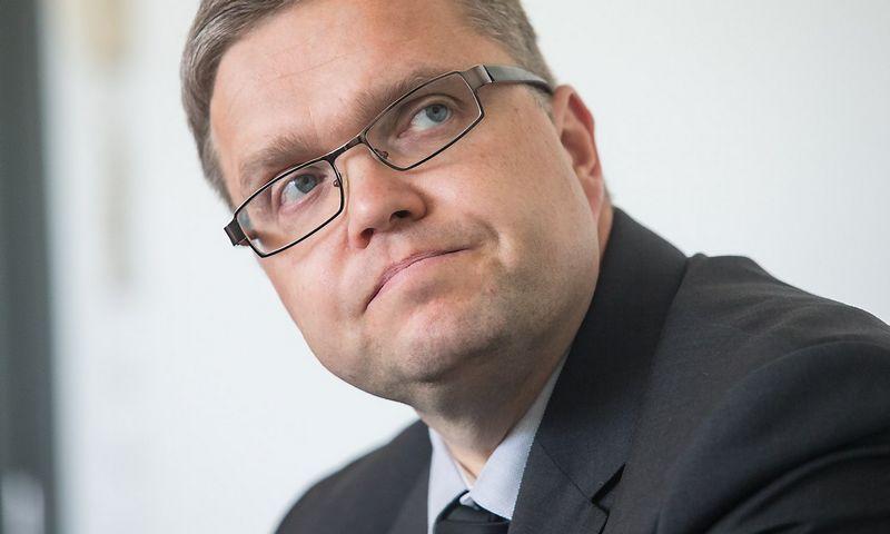 Vitas Vasiliauskas, Lietuvos banko valdybos pirmininkas, sako, kad beveik visi bankai numato, jog kitąmet paskolins daugiau, nei grįš anksčiau suteiktų paskolų. Juditos Grigelytės (VŽ) nuotr.