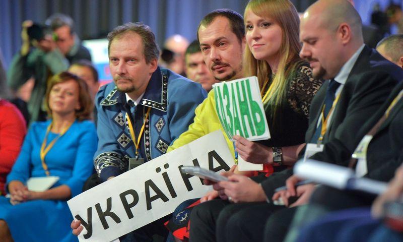 """Iš Ukrainos atvykę žurnalistai Putino klausė apie Rusijos karius Rytų Ukrainoje. Aleksejaus Družinino (""""Sputnik"""" / """"Scanpix"""") nuotr."""