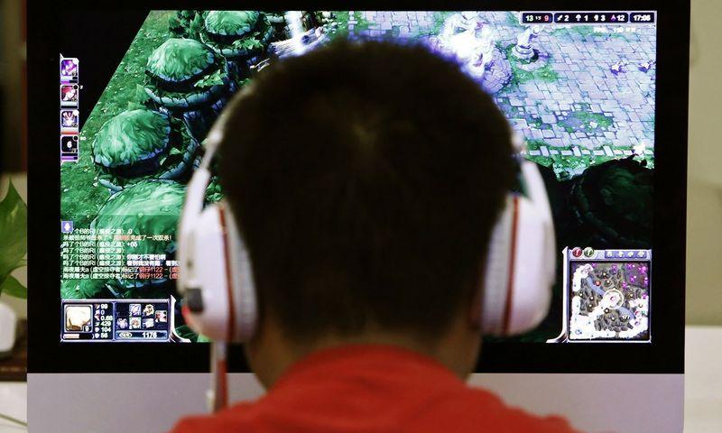 """Kompiuteriniai žaidimai ne tik smagi laisvalaikio pramoga, bet ir būdas užsidirbti pragyvenimui. """"Reuters"""" / """"Scanpix"""" nuotr."""