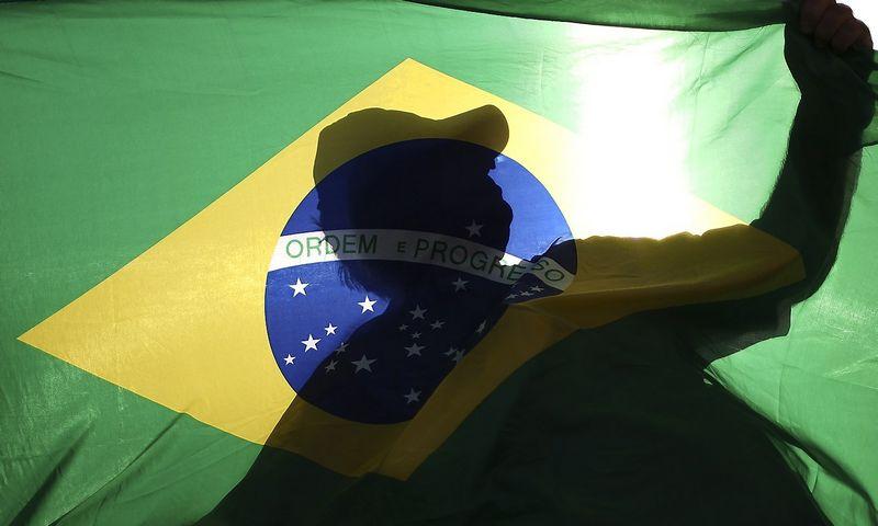 """Daugiausiai besivystančių rinkų obligacijų fondai investuoja į Brazilijos, Rusijos, Kolumbijos skolą. Ueslei Marcelino (""""Reuters""""/""""Scanpix"""") nuotr."""