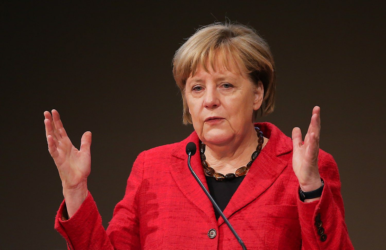 """Merkel apie """"Brexit"""": yra svarbesnių dalykų nei individualūs verslo interesai"""