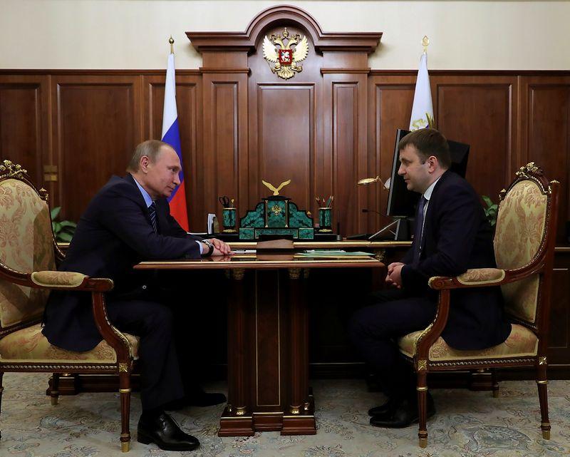 "Vladimiras Putinas ir Maksimas Oreškinas. Michailo Klimentijevo (""Sputnik"" /""Reuters"" / ""Scanpix"") nuotr."