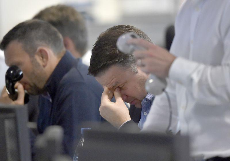 """Įtampos rinkose netrūks ir kitais metais. Toby Melville'io (""""Reuters"""" / """"Scanpix"""") nuotr."""
