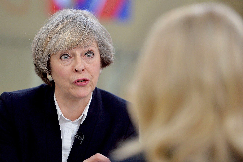 """Theresa May, JK premjerė, pirmadienį sukėlė valiutų rinkos dalyvių nerimą.  Johno Stillwello (""""Reuters""""/""""Scanpix"""") nuotr."""