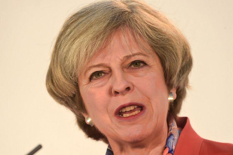 """Theresa May, JK premjerė. Rebeccos Naden (""""Reuters"""" / """"Scanpix"""") nuotr."""