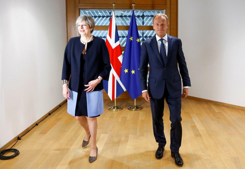 Theresa May pažadėjo neišvaryti imigrantų iš ES