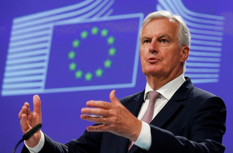 """Barnier įspėja – """"Brexit"""" derybos vėluoja"""