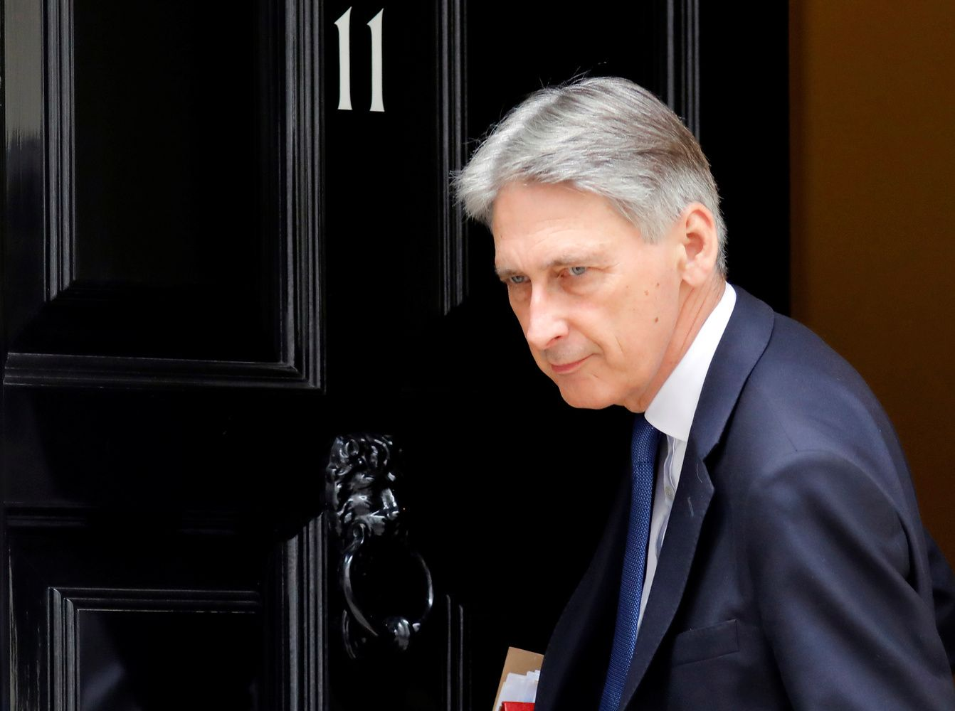 Hammond Envisages `Business as Usual' Brexit Transition