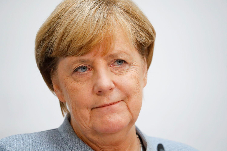 Merkel išreiškė atsargų pritarimą Macrono reformoms
