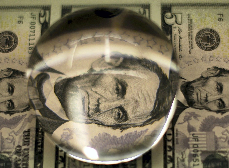 Dollar Drops, Stocks Mixed as Fed Chief Pick Looms: Markets Wrap