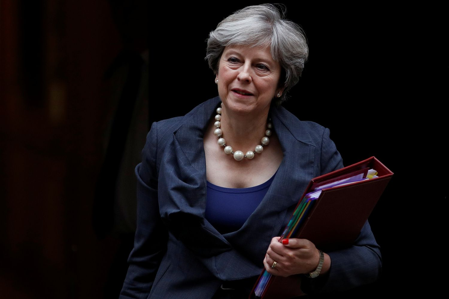 May Heads to Brussels as Lawmakers Move to Block No-Deal Brexit