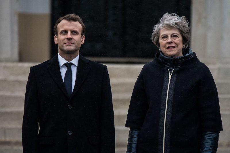 """Emmanuelis Macronas, Prancūzijos prezidentas, ir Theresa May, Jungtinės Karalystės premjerė. Vianney Le Caer (""""Reuters""""/""""Scanpix"""") nuotr."""