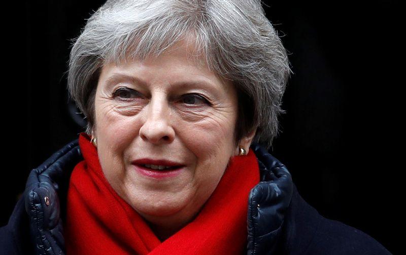 """Theresa May žada, kad JK jau gyvenantiems ES piliečiams nebus sudėtinga čia likti. Peterio Nichollso (""""Reuters""""/""""Scanpix"""") nuotr."""