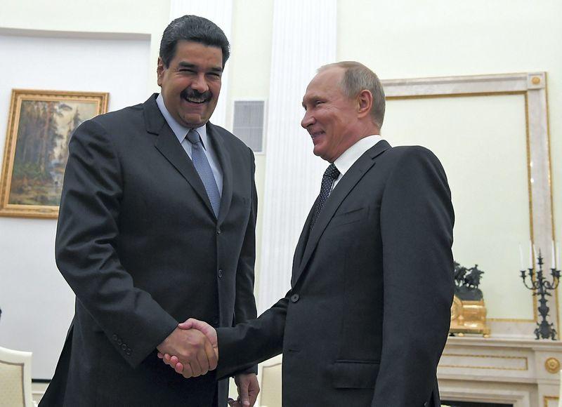 Vladimiras Putinas, Rusijos prezidentas, susitinka su Niolasu Maduro, Venesuelos vadovu. Jurijaus Kadobnovo (Reuters / Scanpix) nuotr.