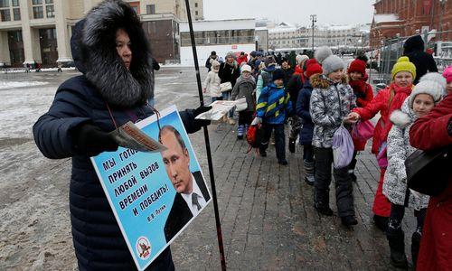 Rusijoje – prezidento rinkimai: 69% rinkėjų žada paremti Putiną