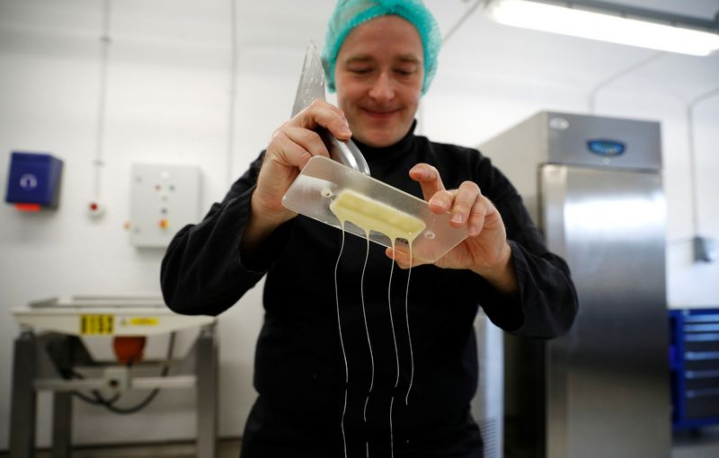 Nestle's Jan Kuendiger removes excess white chocolate from a mould in a kitchen at the company's Product Technology Centre in York, Britain, March 21, 2018. Picture taken March 21, 2018. REUTERS/Phil Noble