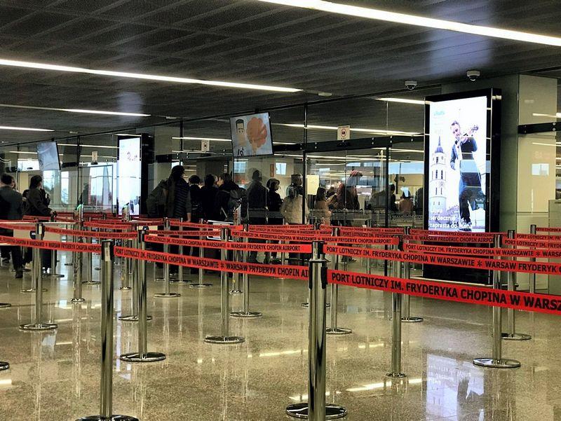Stendas Varšuvos Šopeno oro uoste, kviečiantis aplankyti Vilnių. valstybinio turizmo departamento nuotr.