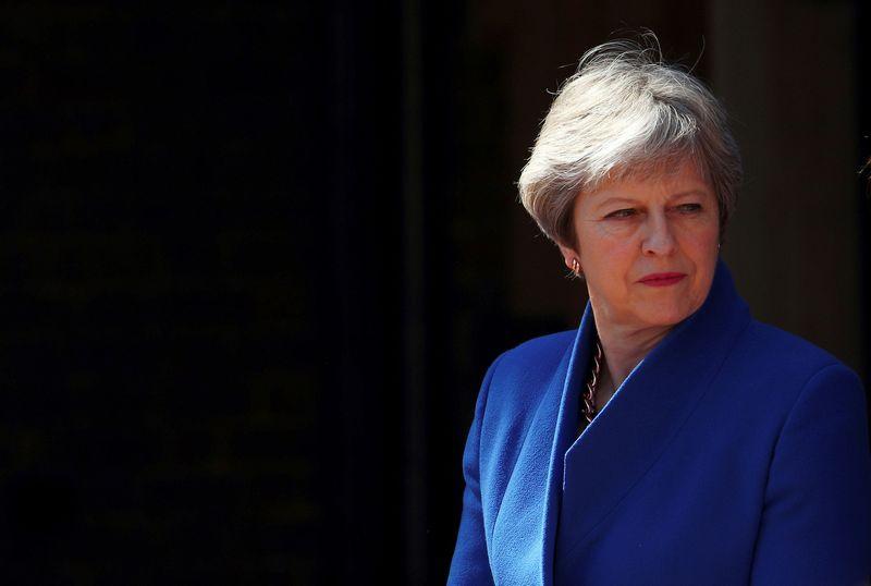 "Jungtinės Karalystės premjerė Theresa May. Hannah McKay (""Reuters"" / ""Scanpix"") nuotr."