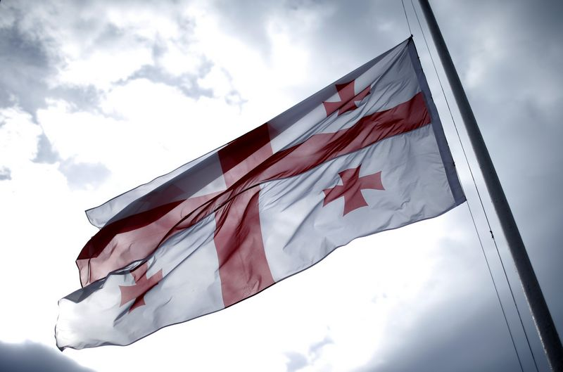 "Gruzijos vėliava. Davido Mdzinarishvili (""Reuters""/""Scanpix"") nuotr."