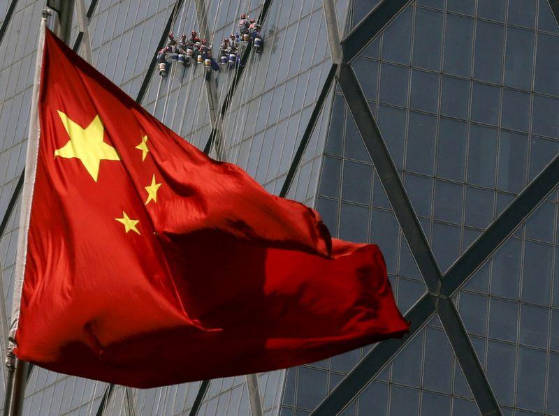 """Kinijos vėliava. Kimo Kyung-Hoono (""""Reuters"""" / """"Scanpix"""") nuotr."""