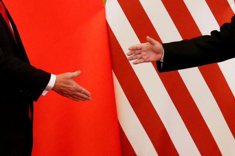 "JAV ir Kinija. Damiro Sagoljevo (""Reuters"" / ""Scanpix"") nuotr."