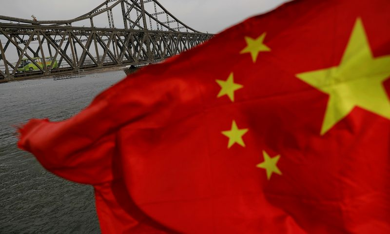 "Kinijos vėliava. Damiro Sagoljo (""Reuters"" / ""Scanpix"") nuotr."