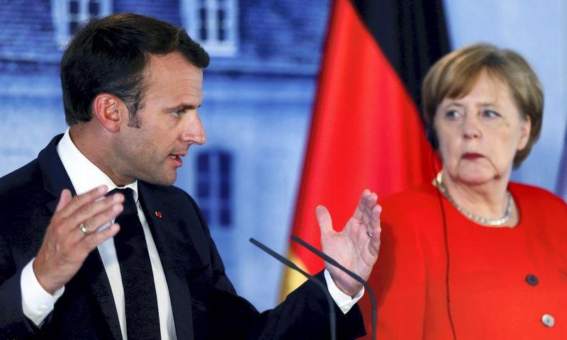 "Vokietijos ir Prancūzijos lyderiai Angela Merkel ir Emmanuelis Macronas. Hannibalo Hanschkės (""Reuters"" / ""Scanpix"") nuotr."