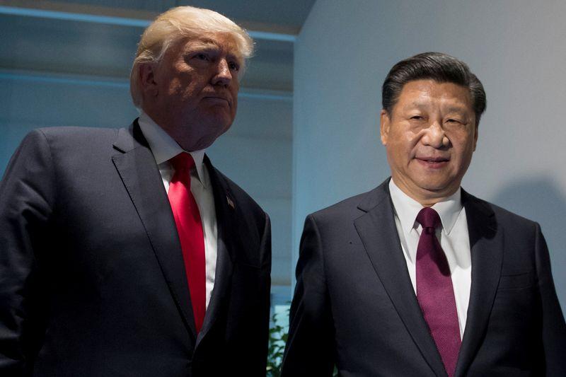 """JAV prezidentas Donaldas Trumpas ir Kinijos prezidentas Xi Jinpingas. Saulo Loebo (""""Reuters""""/ Scanpix"""") nuotr."""