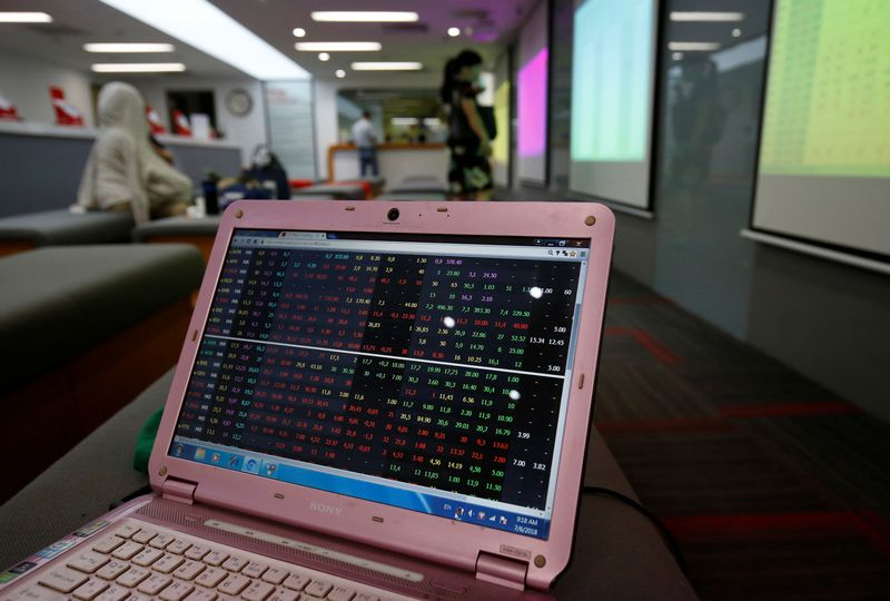 A screen displays stock board information at a securities company in Hanoi, Vietnam July 6, 2018. Picture taken July 6, 2018.  REUTERS/Kham