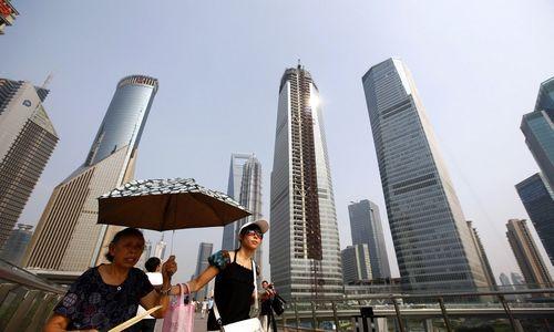 Kinijos BVP augimas lėtėjo, tačiau vis daratitiko valdžios tikslą