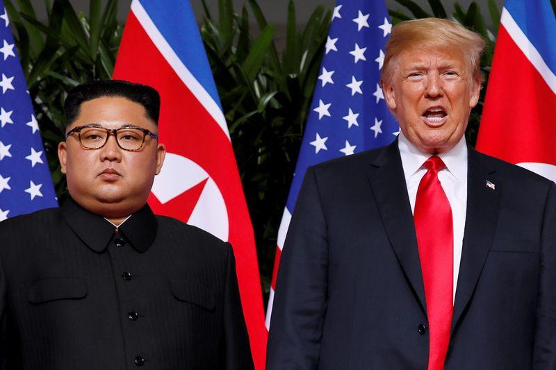 """Šiaurės Korėjos lyderis Kim Jong Unas ir JAV prezidentas Donaldas Trumpas. Jonathano Ernsto (""""Reuters"""" / """"Scanpix"""") nuotr."""