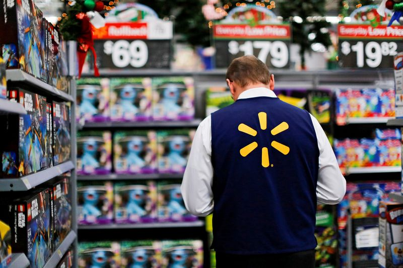 FILE PHOTO: A Walmart worker organises products for Christmas season at a Walmart store in Teterboro, New Jersey, U.S., October 26, 2016. REUTERS/Eduardo Munoz/File Photo