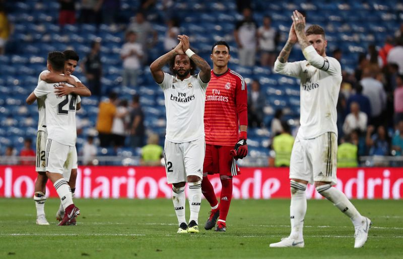 """""""Real"""" pirmosiose Ispanijos čempionato rungtynėse pasiekė pergalę aikštėje, bet ne tribūnose. """"Reuters"""" / """"Scanpix"""" nuotr."""